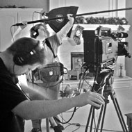 Gordon's documentary crew executes a dolly shot of Charlie's director character, 'Alan Smithee.'