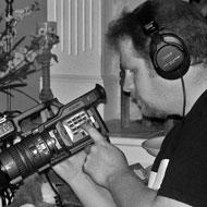 Gordon wrecks the camera settings for optimal amateurism before the opening shot of 'Redlight.'