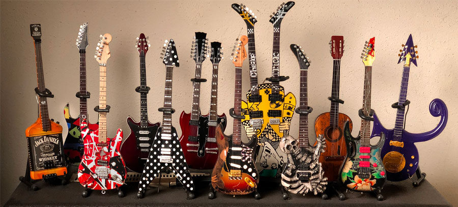 photo of a collection of miniature guitar replicas
