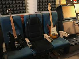 Braniff airplane seats, Peavey Wolfgang EVH, Fender American Deluxe Strat, Tech 21 Power Engine, Lin6 Flextone, Alesis QS6, gig tub